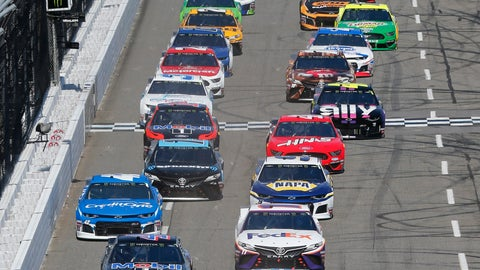 <p>               Joey Logano (22) leads the field at the start of a NASCAR Cup Series auto race at Martinsville Speedway in Martinsville, Va., Sunday, March 24, 2019. (AP Photo/Steve Helber)             </p>