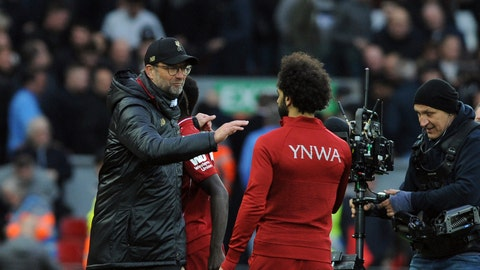 <p>               Liverpool manager Juergen Klopp, left, celebrates with Liverpool's Mohamed Salah at the end of the English Premier League soccer match between Liverpool and Tottenham Hotspur at Anfield stadium in Liverpool, England, Sunday, March 31, 2019. (AP Photo/Rui Vieira)             </p>