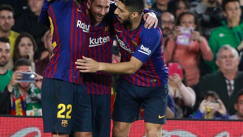<p>               Barcelona's Messi, centre, celebrates after scoring with teammate Aleix Vidal, left, and Suarez during the La Liga soccer match between Betis and Barcelona at the Benito Villamarin stadium in Seville, Spain, Sunday, March 17, 2019. (AP Photo/Miguel Morenatti)             </p>