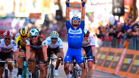 <p>               French rider Julian Alaphilippe, right, celebrates as he crosses the finish line to win, as Oliver Naesen, at his left, of AG2R, comes in second, and Michal Kwiatkowski of Team Sky, left, third, after a 10-man sprint at the end of the 291-kilometer (181-mile) route along the Italian Riviera for the 110th edition of the Milano-Sanremo cycling classic, in Sanremo, Italy, Saturday, March 23, 2019. (Dario Belinghieri/ANSA via AP)             </p>