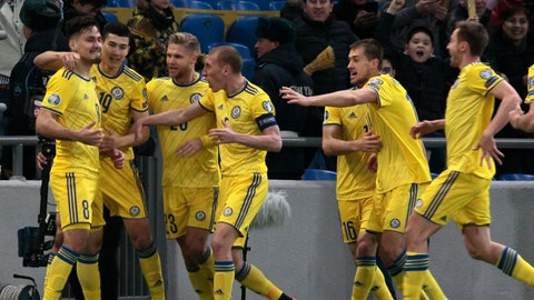 <p>               Kazakhstan's players celebrate after Kazakhstan's Yuriy Pertsukh, left, scored his side's opening goal during the Euro 2020 group I qualifying soccer match between Kazakhstan and the Scotland at Astana Arena stadium in Astana, Kazakhstan, Thursday, March 21, 2019. (AP Photo/Alexei Filippov)             </p>
