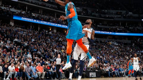 <p>               Oklahoma City Thunder forward Paul George, front, dunks as Denver Nuggets guard Will Barton watches during the first half of an NBA basketball game Tuesday, Feb. 26, 2019, in Denver. (AP Photo/David Zalubowski)             </p>