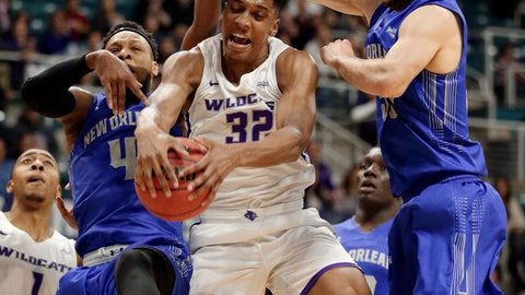 <p>               Abilene Christian forward Joe Pleasant (32) pulls in a rebound between New Orleans guard Bryson Robinson (4) and forward Scott Plaisance Jr., right, during the first half of an NCAA college basketball game for the Southland Conference men's tournament title Saturday, March 16, 2019, in Katy, Texas. (AP Photo/Michael Wyke)             </p>