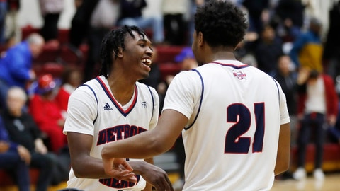 <p>               Detroit Mercy guards Antoine Davis, left, and Lamar Hamrick (21) greet each other after the team's 87-85 win over IUPUI in an NCAA college basketball game, Thursday, Feb. 28, 2019, in Detroit. Davis broke Stephen Curry's freshman 3-point record early in the second half and finished with 20 points. Davis swished a 30-footer from the right wing for shot No. 123 beyond the arc to surpass the mark Curry set at Davidson 12 years ago. (AP Photo/Carlos Osorio)             </p>