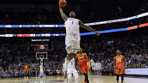 <p>               Duke's Zion Williamson (1) goes up to dunk against Syracuse during the first half of an NCAA college basketball game in the Atlantic Coast Conference tournament in Charlotte, N.C., Thursday, March 14, 2019. (AP Photo/Chuck Burton)             </p>