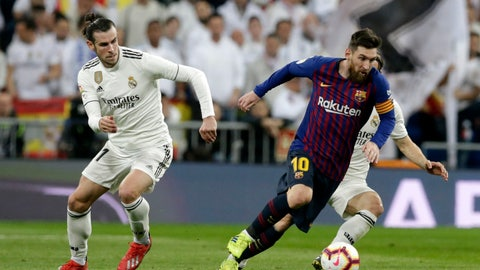 <p>               Barcelona forward Lionel Messi, right, controls the ball as Real midfielder Gareth Bale looks on during the Spanish La Liga soccer match between Real Madrid and FC Barcelona at the Bernabeu stadium in Madrid, Saturday, March 2, 2019. (AP Photo/Andrea Comas)             </p>