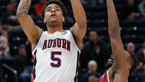 <p>               Auburn Tigers forward Chuma Okeke (5) shoots as New Mexico State forward C.J. Bobbitt (13) defends in the first half during a first round men's college basketball game in the NCAA Tournament, Thursday, March 21, 2019, in Salt Lake City. (AP Photo/Rick Bowmer)             </p>