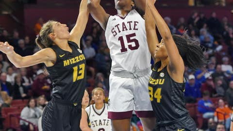 <p>               Mississippi State's Teaira McCowan (15) shoots while defended by Missouri's Emmanuelle Tahane (34) and Hannah Schuchts during the first half of an NCAA college basketball game in the Southeastern Conference women's tournament Saturday, March 9, 2019, in Greenville, S.C. (AP Photo/Richard Shiro)             </p>