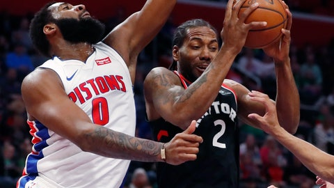 <p>               Toronto Raptors forward Kawhi Leonard (2) pulls down a rebound as Detroit Pistons center Andre Drummond (0) defends during the first half of an NBA basketball game Sunday, March 17, 2019, in Detroit. (AP Photo/Carlos Osorio)             </p>