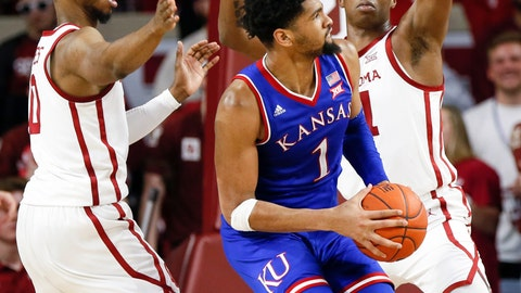 <p>               Kansas forward Dedric Lawson, center, tries to get to the basket between Oklahoma guard Christian James, left, and forward Kristian Doolittle, right, in the second half of an NCAA college basketball game in Norman, Okla., Tuesday, March 5, 2019. Oklahoma won 81-68. (AP Photo/Nate Billings)             </p>