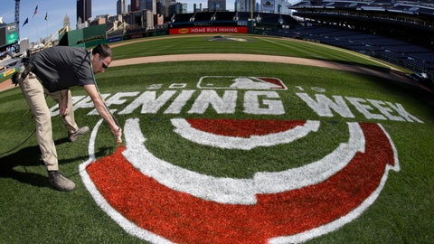 <p>               Andy Burnette, of the PNC Ground Crew paints, the Opening Week logo on the field at PNC Park Wednesday, March 27, 2019 in preparation for the Pittsburgh Pirates home-opener on Monday, April 1, against the St. Louis Cardinals. (AP Photo/Gene J. Puskar)             </p>
