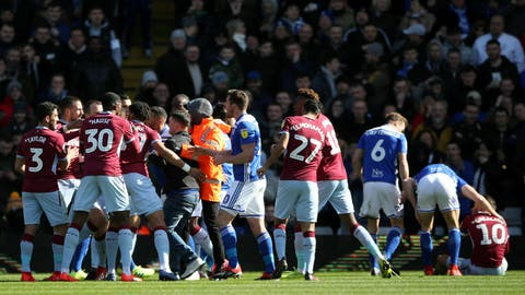 <p>               A fan is removed after attacking Aston Villa's Jack Grealish, right, on the pitch during the Sky Bet Championship soccer match at St Andrew's Trillion Trophy Stadium, Birmingham, England, Sunday March 10, 2019. (Nick Potts/PA via AP)             </p>