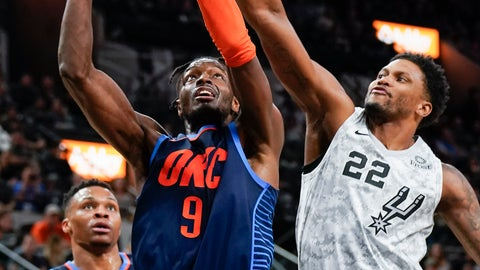 <p>               Oklahoma City Thunder's Jerami Grant (9) attempts to shoot against San Antonio Spurs' Rudy Gay (22) as Thunder guard Russell Westbrook looks on during the first half of an NBA basketball game, Saturday, March 2, 2019, in San Antonio. (AP Photo/Darren Abate)             </p>