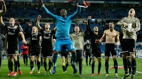 <p>               Ajax players celebrate after the Champions League round of 16 second leg soccer match between Real Madrid and Ajax at the Santiago Bernabeu stadium in Madrid, Tuesday, March 5, 2019. Ajax won 4-1. (AP Photo/Bernat Armangue)             </p>
