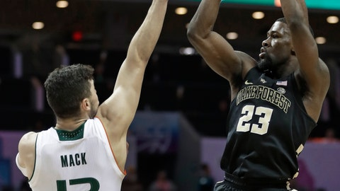 <p>               Wake Forest's Chaundee Brown (23) shoots over Miami's Anthony Mack (13) during the first half of an NCAA college basketball game in the Atlantic Coast Conference tournament in Charlotte, N.C., Tuesday, March 12, 2019. (AP Photo/Nell Redmond)             </p>
