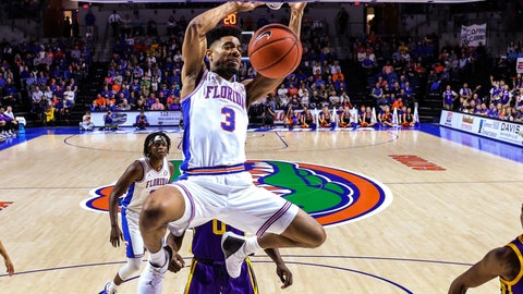 """<p>               FILE - In this March 6, 2019, file photo, Florida guard Jalen Hudson (3) dunks during the second half of an NCAA college basketball game against LSU in Gainesville, Fla. Hudson sent one text seconds after Florida's opponent in the NCAA Tournament was announced. The senior guard messaged the """"eyes"""" emoji to close friends, former Amateur Athletic Union teammates and current Nevada standouts Caleb and Cody Martin. (AP Photo/Gary McCullough, File)             </p>"""