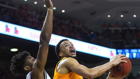 <p>               Auburn forward Anfernee McLemore (24) defends as Tennessee guard Lamonte Turner (1) looks to shoot during the first half of an NCAA college basketball game Saturday, March 9, 2019, in Auburn, Ala. (AP Photo/Julie Bennett)             </p>