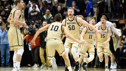 <p>               Wofford guard Fletcher Magee (3), guard Nathan Hoover (10), center Matthew Pegram (50), guard Ryan Larson (11) and guard Trevor Stumpe (15) celebrates their team's 70-58 win over UNC-Greensboro for the Southern Conference tournament championship, Monday, March 11, 2019, in Asheville, N.C.  (AP Photo/Kathy Kmonicek)             </p>