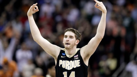 <p>               Purdue's Ryan Cline celebrates after hitting a shot against Tennessee during the second half of a men's NCAA Tournament college basketball South Regional semifinal game Thursday, March 28, 2019, in Louisville, Ky. (AP Photo/Michael Conroy)             </p>