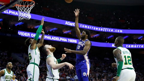 <p>               Philadelphia 76ers' Joel Embiid (21) shoots as Boston Celtics' Terry Rozier, from right, Aron Baynes, Marcus Smart and Al Horford watch during the first half of an NBA basketball game, Wednesday, March 20, 2019, in Philadelphia. (AP Photo/Matt Slocum)             </p>