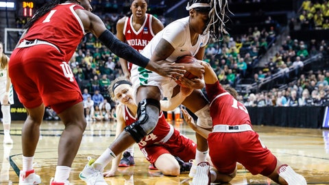 <p>               Oregon forward Ruthy Hebard (24), fights for a loose ball against Indiana guard Jaelynn Penn (13), during a second-round game of the NCAA women's college basketball tournament Sunday, March 24, 2019, in Eugene, Ore. (AP Photo/Thomas Boyd)             </p>