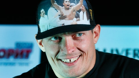 <p>               FILE - In this Wednesday, Aug. 1, 2018 file photo, Oleksandr Usyk smiles during a press conference in Kiev, Ukraine. The undisputed world cruiserweight champion, Oleksandr Usyk, says he's finally moving up to heavyweight. (AP Photo/Efrem Lukatsky. File)             </p>