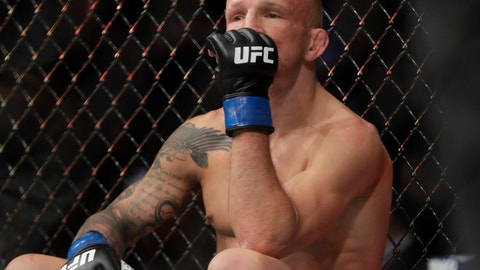 """<p>               FILE - In this Jan. 20, 2019 file photo, TJ Dillashaw reacts after a flyweight mixed martial arts championship bout against Henry Cejudo at UFC Fight Night in New York.  Dillashaw has surrendered the UFC 135-pound championship because of an """"adverse finding"""" in his last drug test. Dillashaw posted on social media that he would give up the belt after he was informed by the New York State Athletic Commission and the United States Anti-Doping Agency of the results of his test leading up to his last fight in January.  Dillashaw suffered first-round loss to Henry Cejudo and failed to become a two-division champion. (AP Photo/Frank Franklin II, File)             </p>"""