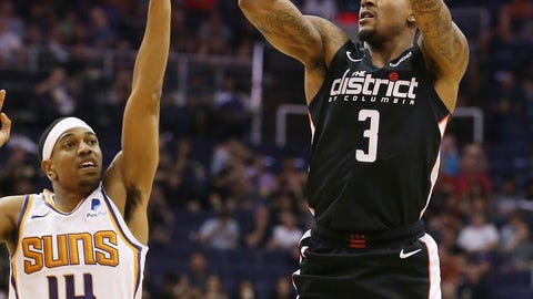 <p>               Washington Wizards guard Bradley Beal (3) shoots a 3-pointer next to Phoenix Suns guard De'Anthony Melton (14) during the second half of an NBA basketball game Wednesday, March 27, 2019, in Phoenix. The Wizards won 124-121. (AP Photo/Ross D. Franklin)             </p>