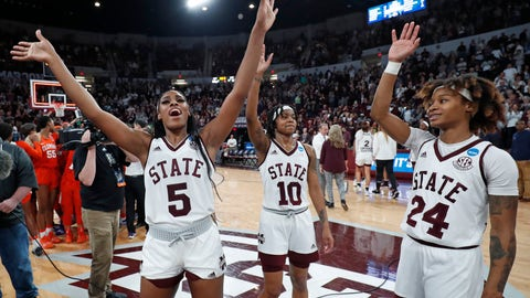 <p>               Mississippi State forward Anriel Howard (5) and guards Jazzmun Holmes (10) and Jordan Danberry (24) salute the crowd as they celebrate the team's 85-61 win over Clemson in a second-round women's college basketball game in the NCAA Tournament in Starkville, Miss., Sunday, March 24, 2019. (AP Photo/Rogelio V. Solis)             </p>