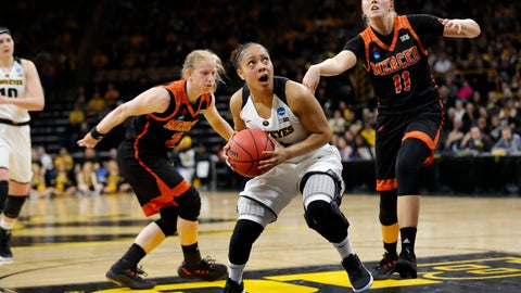 <p>               Iowa guard Tania Davis, center, drives to the basket past Mercer's Amanda Thompson, left, and Linnea Rosendal, right, during a first-round game in the NCAA women's college basketball tournament, Friday, March 22, 2019, in Iowa City, Iowa. (AP Photo/Charlie Neibergall)             </p>