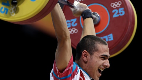 <p>               FILE - In this Sunday, July 29, 2012 file photo, Valentin Hristov of Azerbaijan competes during the men's 56-kg, group A, weightlifting competition at the 2012 Summer Olympics, in London. Hristov took the bronze medal. The IOC says it disqualified Valentin Hristov, the bronze medalist weightlifter from Azerbaijan, among three athletes caught doping with steroids at the 2012 London Olympics. (AP Photo/Mike Groll, File)             </p>