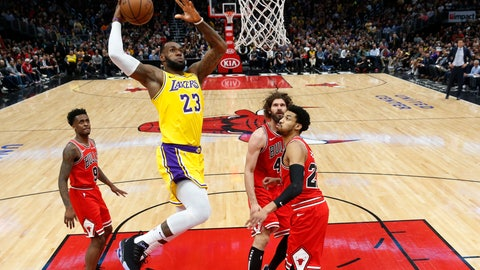 <p>               Los Angeles Lakers forward LeBron James (23) goes for a dunk against the against the Chicago Bulls during the second half of an NBA basketball game Tuesday, March 12, 2019, in Chicago. (AP Photo/Nuccio DiNuzzo)             </p>