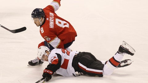 <p>               Ottawa Senators' Oscar Lindberg (24) reaches for the puck as Florida Panthers' Jayce Hawryluk (8) defends during the second period of an NHL hockey game, Sunday, March 3, 2019, in Sunrise, Fla. (AP Photo/Luis M. Alvarez)             </p>