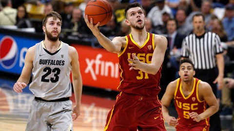 <p>               USC forward Nick Rakocevic, right, drives past Colorado forward Lucas Siewert for a basket in the first half of an NCAA college basketball game Saturday, March 9, 2019, in Boulder, Colo. (AP Photo/David Zalubowski)             </p>