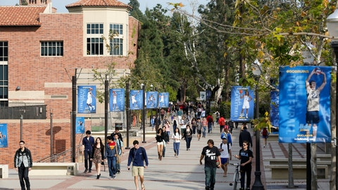 <p>               FILE - In this Feb. 26, 2015, file photo, students walk on the University of California, Los Angeles campus. Federal authorities have charged college coaches and others in a sweeping admissions bribery case in federal court. The racketeering conspiracy charges were unsealed Tuesday, March 12, 2019, against coaches at schools including UCLA, Wake Forest, Stanford, Georgetown, and the University of Southern California. (AP Photo/Damian Dovarganes, File)             </p>