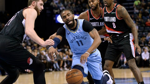 <p>               Memphis Grizzlies guard Mike Conley (11) is fouled as he drives between Portland Trail Blazers center Jusuf Nurkic, from left, and forwards Maurice Harkless and Al-Farouq Aminu (8) in the first half of an NBA basketball game, Tuesday, March 5, 2019, in Memphis, Tenn. (AP Photo/Brandon Dill)             </p>
