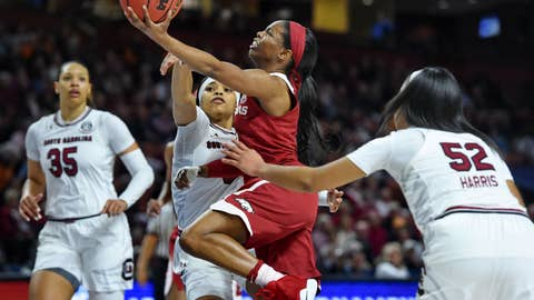 <p>               Arkansas' Malica Monk, center, drives in for a layup while defended by South Carolina's Tyasha Harris during the first half of a women's Southeastern Conference NCAA college basketball tournament game Friday, March 8, 2019, in Greenville, S.C. (AP Photo/Richard Shiro)             </p>