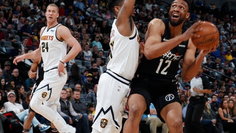 <p>               Washington Wizards forward Jabari Parker, right, goes up for a basket as Denver Nuggets guard Monte Morris defends in the first half of an NBA basketball game Sunday, March 31, 2019, in Denver. (AP Photo/David Zalubowski)             </p>