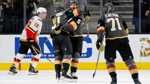 <p>               Vegas Golden Knights defenseman Deryk Engelland (5) celebrates after scoring against the Calgary Flames during the third period of an NHL hockey game Wednesday, March 6, 2019, in Las Vegas. (AP Photo/John Locher)             </p>