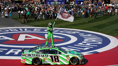 <p>               Kyle Buschs stands on his car after winning the NASCAR Cup Series auto race at Auto Club Speedway in Fontana, Calif., Sunday, March 17, 2019. The win was the 200th for Busch across NASCAR's three national series. (AP Photo/Rachel Luna)             </p>
