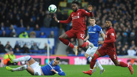 <p>               Liverpool's Divock Origi is tackled by Everton's Morgan Schneiderlin during the English Premier League soccer match between Everton and Liverpool at Goodison Park in Liverpool, England, Sunday, March 3, 2019. (AP Photo/Rui Vieira)             </p>
