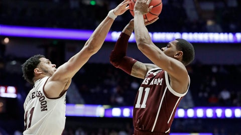 <p>               Mississippi State guard Quinndary Weatherspoon, left, reaches for a shot by Texas A&M guard Wendell Mitchell, right, in the first half of an NCAA college basketball game at the Southeastern Conference tournament Thursday, March 14, 2019, in Nashville, Tenn. (AP Photo/Mark Humphrey)             </p>