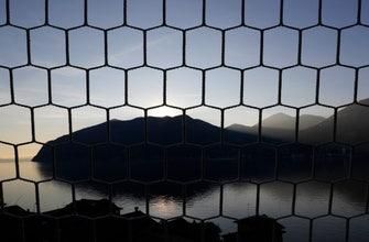 AP Photos: Nets for soccer goals made on an Italian island