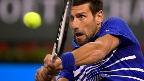 <p>               Novak Djokovic, of Serbia, returns to Bjorn Fratangelo at the BNP Paribas Open tennis tournament Saturday, March 9, 2019, in Indian Wells, Calif. (AP Photo/Mark J. Terrill)             </p>