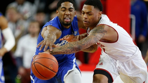 <p>               Buffalo guard CJ Massinburg, left, fights for control of the ball with Miami (Ohio) guard Nike Sibande, right, during the first half of an NCAA college basketball game, Friday, March 1, 2019, in Oxford, Ohio. (AP Photo/Gary Landers)             </p>