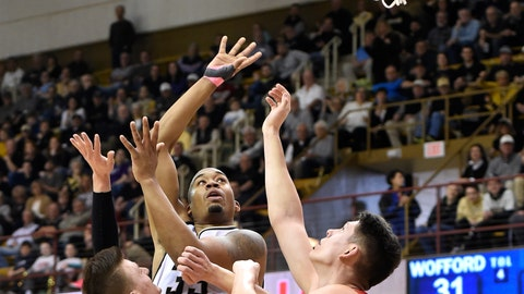 <p>               Wofford forward Cameron Jackson (33) shoots for the basket between Virginia Military forward Will Miller (24) and forward Tyler Creammer (25) in the first half of an NCAA college basketball game in the Southern Conference tournament championship, Saturday, March 9, 2018, in Asheville, N.C. (AP Photo/Kathy Kmonicek             </p>