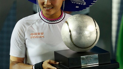 <p>               China's Yafan Wang holds her trophy and wears a Mexican sombrero after winning her Mexican Tennis Open final match against Sofia Kenin of the U.S., in Acapulco, Mexico, Saturday, March 2, 2019. (AP Photo/Rebecca Blackwell)             </p>