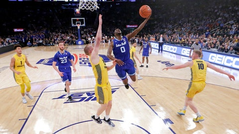 <p>               Seton Hall guard Quincy McKnight (0) goes up for a shot against Marquette forward Joey Hauser (22) during the first half of an NCAA college basketball semifinal game in the Big East men's tournament, Friday, March 15, 2019, in New York. (AP Photo/Julio Cortez)             </p>