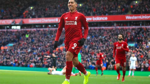 <p>               Liverpool's Roberto Firmino celebrates scoring his side's third goal of the game during the English Premier League soccer match between Liverpool and Burnley at Anfield, Liverpool, England, Sunday, March 10, 2019. (Peter Byrne/PA via AP)             </p>