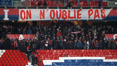 """<p>               Empty stands and a banner reading """"We Won't Forget"""" referring to PSG's Champions League loss against Manchester United are seen during the French League One soccer match between Paris-Saint-Germain and Olympique Marseille at the Parc des Princes stadium in Paris, Sunday, March 17, 2019. (AP Photo/Christophe Ena)             </p>"""